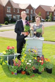 Caption: (BNI) Mark Clare, Group Chief Executive of Barratt Developments with Jane Moseley, of the British Beekeepers Association