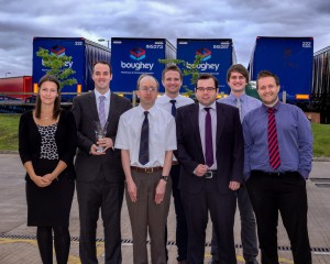 The award-winning IT team holding the UKWA award trophy